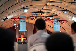 27 October 2019, Addis Ababa, Ethiopia: Sunday service at the Finfinne Oromo Mekane Yesus Congregation of the Ethiopian Evangelical Church Mekane Yesus. In a context where congregations did not use to be allowed to hold their services in any language but Amharic, the congregation today is one of some 60 Oromo speaking Mekane Yesus congregations in Addis Ababa. The service takes place on the first Sunday following political turmoil in the country, claiming dozens of lives.