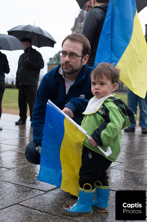 Roman Yakahuzny and his son Maxym pose for a photo during rally against Russian products. April 26, 2014.