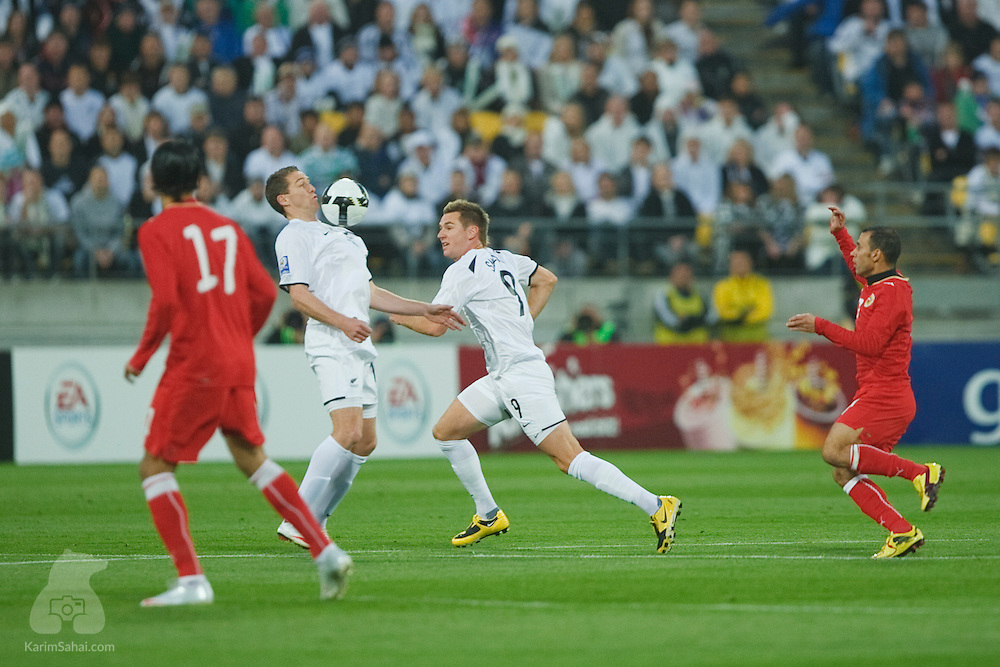 Chris Killen of the New Zealand All Whites controls the ball while Shane Smeltz runs by and bahrainis Husain Ali Hasan Ali (L) and Sayed Mahmood Jalal look on, during the second leg of the 2010 FIFA World Cup qualifying game in front a record 35,194 football fans at Westpac Stadium on November 14, 2009. New Zealand beat Bahrain 1-0 and secured a spot at the 2010 World Cup in South Africa.