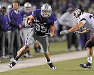 MANHATTAN, KS - OCTOBER 17:  Tight end Jeron Mastrud #85 of the Kansas State Wildcats rushes up field around pressure from linebacker Michael Hodges #37 of the Texas A&M Aggies on October 17, 2009 at Bill Snyder Family Stadium in Manhattan, Kansas.  (Photo by Peter G. Aiken/Getty Images)