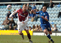 Photo: Ian Hebden.<br />Peterborough United v Northampton Town. Coca Cola League 2. 01/04/2006.<br />Northamptons Martin Smith (L) and Peterboroughs Paul Carden challenge for the ball.