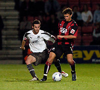 Photo: Leigh Quinnell.<br /> AFC Bournemouth v Bristol City. Coca Cola League 1. 26/09/2006. Bristol Citys Jamie McAllister keeps an eye on Bournemouths Stephen Purches.