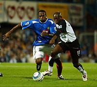 Fotball<br /> England<br /> Foto: SBI/Digitalsport<br /> NORWAY ONLY<br /> <br /> Portsmouth v Fulham<br /> <br /> Barclays Premiership. 30/08/2004<br /> <br /> Ricardo Fuller of Portsmouth clashes with Luis Boa Morte of Fulham