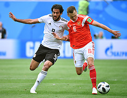 SAINT PETERSBURG, June 19, 2018  Denis Cheryshev (R) of Russia vies with Marwan Mohsen of Egypt during a Group A match between Russia and Egypt at the 2018 FIFA World Cup in Saint Petersburg, Russia, June 19, 2018. (Credit Image: © Li Ga/Xinhua via ZUMA Wire)