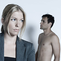 studio shot on isolated background of a beautiful heterosexual couple with the man naked