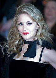 © Licensed to London News Pictures. 11/01/2012. London, UK.  Madonna arriving at the Premier of W.E. at The Odeon, Kensington High Street, London on January 11th, 2012. Madonna directed W.E. which is a drama about the relationship between Wallis Simpson and Edward VIII.  Photo credit : Ben Cawthra/LNP