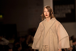 © Licensed to London News Pictures. 05/06/2016. London, UK. A model presents a look by Thi Hang Doan, from the University of East London. Graduate Fashion Week opens at the Old Truman Brewery in East London showcasing the work of over 1,000 of the very best graduates from over 40 universities around the world.  30,000 guests are expected to attend the annual event which features 22 catwalk shows and more. Photo credit : Stephen Chung/LNP