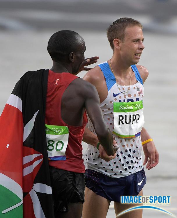 Aug 21, 2016; Rio de Janeiro, Brazil; Marathon winner Eliud Kipchoge (KEN), left, shakes hands with third-place finisher Galen Rupp (USA) during the Rio 2016 Summer Olympic Games at Sambodromo.