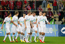 Players of team Slovenia celebrate during the FIFA World Cup 2014 Group E qualification match between Slovenia and Norway on October 11, 2013 in Stadium Ljudski vrt, Maribor, Slovenia. (Photo by Urban Urbanc / Sportida)