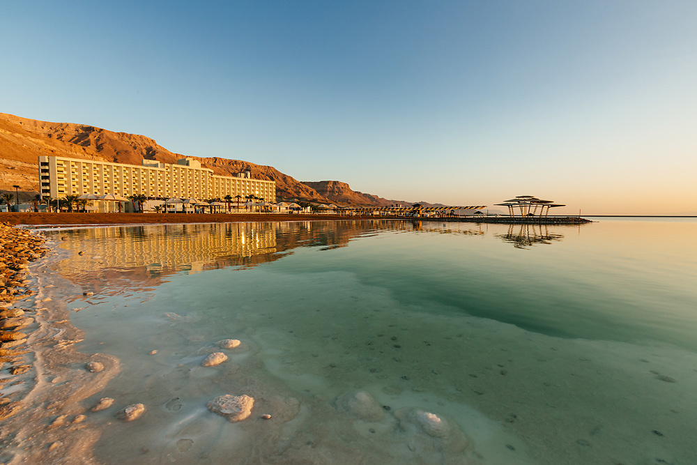 A view of the Herods Dead Sea Hotel in Ein Bokek, during sunrise over the Dead Sea, Israel