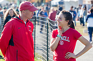 New York, New York - A Cornell University coach talks to one of his runners before the Ivy League Heptagonal women's<br /> cross country championship meet at Van Cortlandt Park in the Bronx on Oct. 26, 2017.