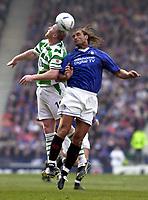 Photo: Greig Cowie<br />CIS Scottish Cup Final. Celtic v Rangers. Hampden Park Glasgow. 16/03/2003<br />Lorenzo Amoruso and John Hartson compete