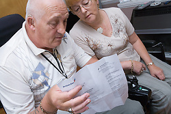 Disabled couple discussing bills together,