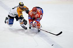 Stefan Herzog of Graz vs Robert Sabolic of Acroni Jesenice during ice hockey match between HK Acroni Jesenice and  Moser Medical Graz 99ers in 24th Round of EBEL league, on December 3, 2010 in Arena Podmezakla, Jesenice, Slovenia.  (Photo By Vid Ponikvar / Sportida.com)