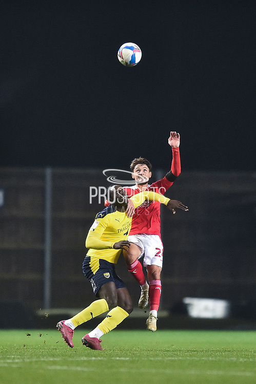 Oxford United forward Daniel Agyei (19) battles for possession with Swindon Twn Defender Rob Hunt (24) during the EFL Sky Bet League 1 match between Oxford United and Swindon Town at the Kassam Stadium, Oxford, England on 28 November 2020.