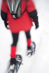 North America, United States, Washington, woman snowshoeing on Crystal Mountain (blurred motion)