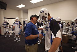 31 May 2010: Duke Blue Devils midfielder Justin Turri (12) with assistant coach Ron Captuto before playing the Notre Dame Irish in the NCAA Lacrosse Championship at M&T Bank Stadium in Baltimore, MD.  The Blue Devils would go on that day to win the national title.