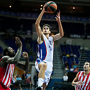 Anadolu Efes's Furkan Korkmaz (C) and Olympiacos's Kostas Sloukas (R) during their Gloria Cup Basketball Tournament match Anadolu Efes between Olympiacos at Ulker Sports Arena in istanbul Turkey on Tuesday 23 September 2014. Photo by Aykut AKICI/TURKPIX