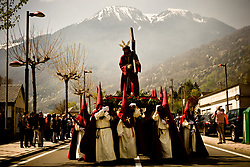 April 14, 2017 - Bossost, Lleida, Spain - In the aranes village of Bossost penitents carrying an image of Christ and take part to the Holy Friday procession. In the village of Bossost, Pyrenees mountains at Vall d'Aran region, neighbours take to the streets every year to held the holy friday procession. Bossost is the village that still holds this tradition in the Vall d'Aran region and has its origins from 1879. (Credit Image: © Jordi Boixareu via ZUMA Wire)