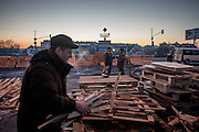 "Oleg (left) collecting wood for heating at the barrikades blockading a building supplies store named ""Epicenter"" in the city of Lviv, Ukraine."