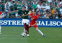 May 28, 2018 - Pasadena, CA, U.S. - PASADENA, CA - MAY 28: Aaron Ramsey of Wales fights HŽctor Herrera of Mexico  for the ball  during the game on May 28, 2018, at the Rose Bowl in Pasadena, CA.  (Photo by Adam  Davis/Icon Sportswire) (Credit Image: © Adam Davis/Icon SMI via ZUMA Press)