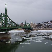 Freedom bridge is seen over river Danube in the winter cityscape in Budapest, Hungary on February 15, 2012. ATTILA VOLGYI
