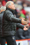 AFC Wimbledon manager Glyn Hodges gesturing during the EFL Sky Bet League 1 match between Charlton Athletic and AFC Wimbledon at The Valley, London, England on 12 December 2020.