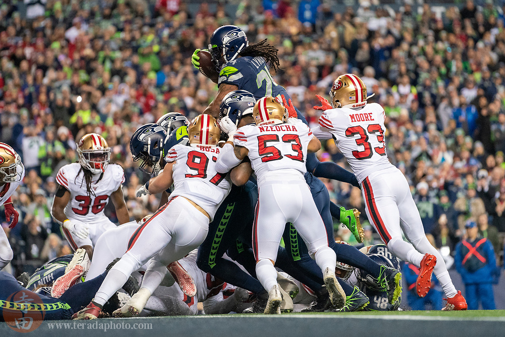 December 29, 2019; Seattle, Washington, USA; Seattle Seahawks running back Marshawn Lynch (24) scores a touchdown during the fourth quarter against the San Francisco 49ers at CenturyLink Field.