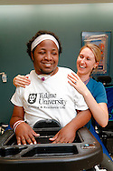 Photograph of ex-Tulane football star Devon Walker during his physical therapy at Touro Infirmary in New Orleans, LA.