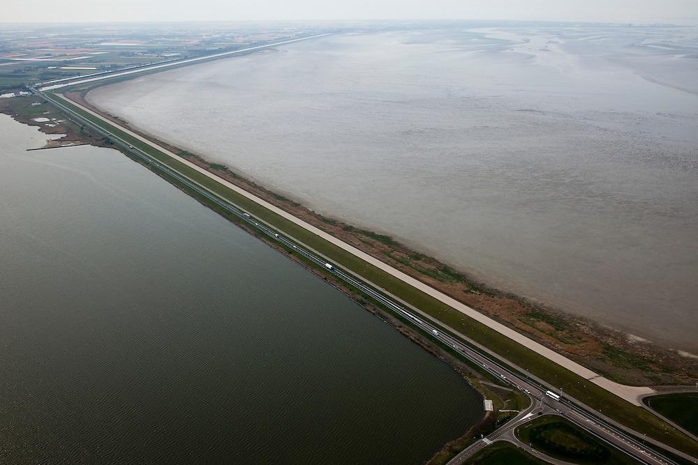 Nederland, Noord-Holland, Gemeente Wieringen, 28-04-2010; Amsteldiepdijk tussen Amstelmeer (li) met Balgzand (re). De dijk uit 1924 sloot het Amsteldiep af en diende mede als voorbeeldproject voor de Afsluitdijk, vandaar de bijnaam Korte of Kleine Afsluitdijk. Het Balgzand maakt deel uit van het Waddengebied. .Amsteldiep Dike between Amstelmeer (li) with Balgzand (er). The dike, build  in 1924, also served as a model project for the Afsluitdijk ('Enclosure Dam'), hence the nickname Short or Small Enclosure Dam. The Balgzand is part of the Wadden Sea..luchtfoto (toeslag), aerial photo (additional fee required).foto/photo Siebe Swart
