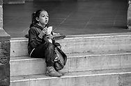 After school this girl had her snack while watching an intense street soccer match of older boys in Montalcino, Italy