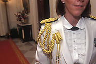 A FEMALE MILITARY AIDE DETAILED TO THE WHITE HOUSE FOR CEREMONIAL OCCASIONS IN THE GRAND FOYER, PRIOR TO A STATE DINNER.