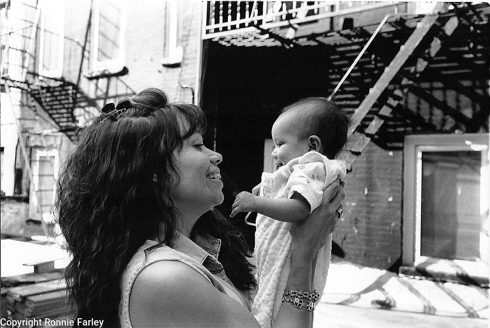 Lori Pourier, (Lakota) holds her 3 month old daughter Shahiyela (Lakota,Cheyenne) while visiting New York City from South Dakota in 1999.