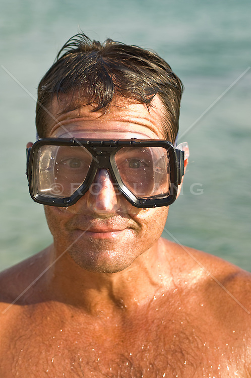 Wet Man In Scuba Goggles Making A Funny Face