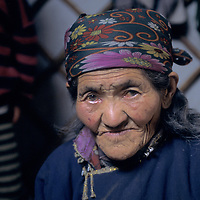 MONGOLIA, Darhad Valley. 86 year old Dejid, who will join her family's fall migration by riding on a travois drawn by oxen.