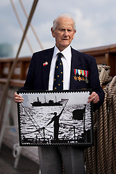 © Licensed to London News Pictures. 18/09/2013. London, UK. Captain Gwilym Williams, 98, a World War Two veteran of the Merchant Navy, holds a new Royal Mail showing scenes from World War Two Atlantic and Arctic convoys during their launch at the Cutty Sark in Greenwich, London, today (18/09/2013). The stamps, issued along with others depicting famous merchant ships including the Cutty Sark, are available from the 19th of September 2013. Photo credit: Matt Cetti-Roberts/LNP