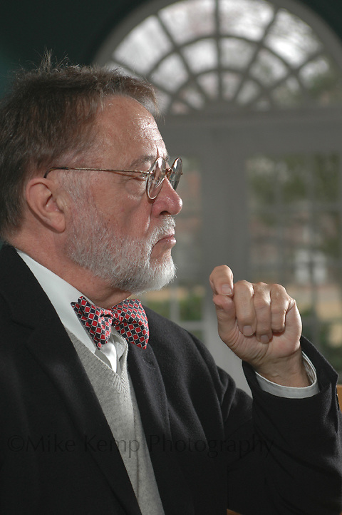 With the Georgian style window that is a hallmark of UCA in the background, Honors College founder Norb Schedler poses for a portrait prior to his retirement.