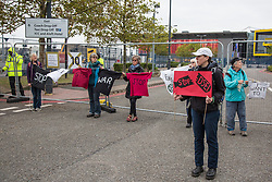 London, UK. 6 September, 2019. Activists take part in Stop The Arms Fair protests outside ExCel London on the fifth day of a week-long carnival of resistance against DSEI, the world's largest arms fair. The fifth day of protests was themed as Stop The Arms Fair: Stop Climate Change in order to highlight links between the fossil fuel and arms industries.