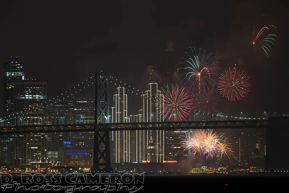 Fireworks light up the skyline of San Francisco to celebrate the New Year, Sunday, Jan. 1, 2017, as seen from Middle Harbor Shoreline Park at the Port of Oakland, Calif. (Photo by D. Ross Cameron)