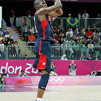 31 July 2012: USA Kevin Durant takes a jumpshot during 110-63 Team USA victory over Team Tunisia, during the men's basketball preliminary, at the Basketball Arena, in London, Great Britain.