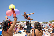 """Sexy attractive young people doing acrobatics as a promotion of Pacha´s David Guetta F""""""""ck me Im famous party in Salinas beach, Ibiza, Spain - Photo by Nano Calvo"""