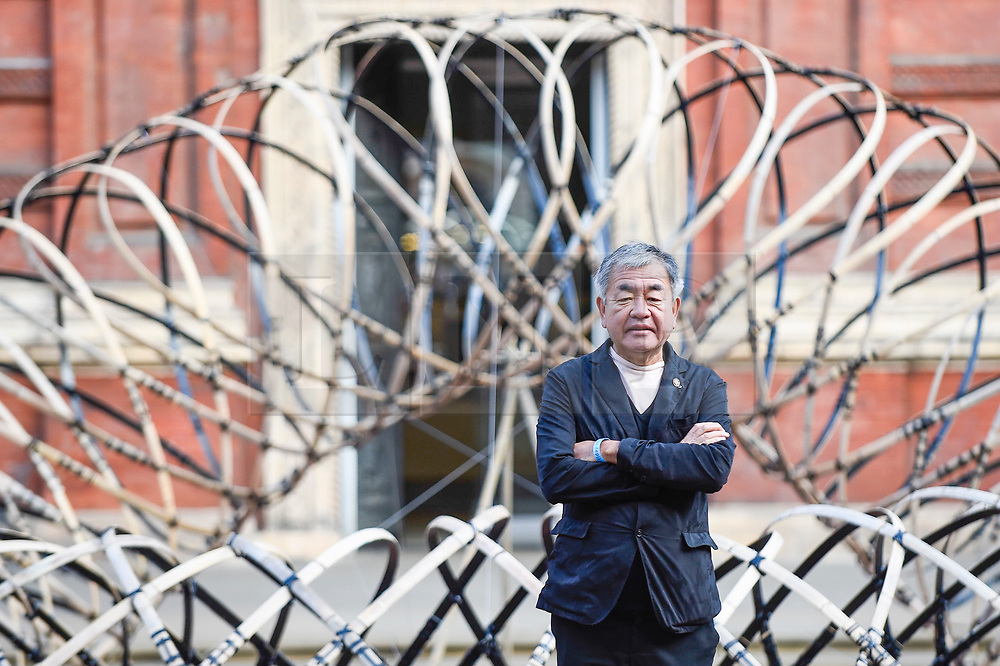 """© Licensed to London News Pictures. 13/09/2019. LONDON, UK. Designer Kengo Kuma in front of his work """"Bamboo Ring"""" on display at the V&A museum as part of London Design Festival.  The festival, now in its 17th year, includes installations across the capital and runs 14 to 22 September 2019.  Photo credit: Stephen Chung/LNP"""