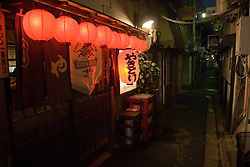 Night view of small bar in Golden Gai district of Shinjuku in Tokyo Japan
