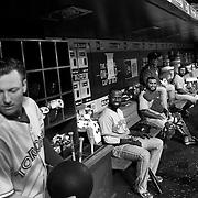 Josh Donaldson, Toronto Blue Jays, exercising with a medicine ball in the dugout watched by Jose Reyes and catchers Dioner Navarro and Russell Martin, (right), during the New York Mets Vs Toronto Blue Jays MLB regular season baseball game at Citi Field, Queens, New York. USA. 15th June 2015. Photo Tim Clayton