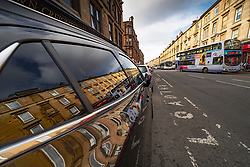 Duke Street in Dennistoun reflected in car window, Glasgow, Scotland, UK
