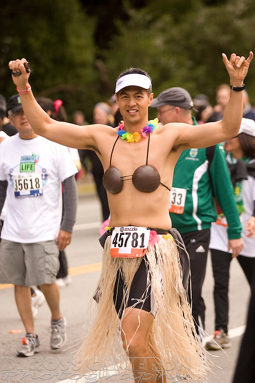 John David of Agoura Hills, Calif. gets excited about a photograph during the 100th running of the Bay to Breakers 12K, Sunday, May 15, 2011 in San Francisco. (Photo by D. Ross Cameron)