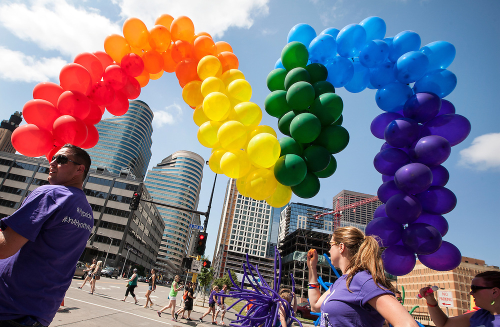 Members of the Hyatt Regency Minneapolis team carry balloon arcs as they line up for the 2015 Ashley Rukes GLBT Pride Parade in Minneapolis June 28, 2015.
