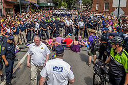 June 25, 2017 - New York, New York, United States - Queer and trans allies, part of the No Justice No Pride movement blocked the NYPD and Toronto Police contingents at the New York City Pride March in pride for Trans and Queer lives. Protesters chained themselves to one another bringing the march to a complete halt. Twelve arrest were made co-facilitated by the Pride March board of directors for blocking police presence out of pride. (Credit Image: © Erik Mcgregor/Pacific Press via ZUMA Wire)
