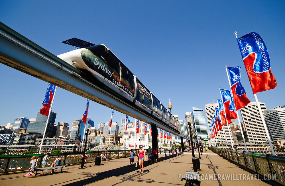 a monorail on Pyrmont Bridge, a pedestrian bridge at Darling Harbour spanning Cockle Bay