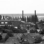 NLD/Huizen/19920622 - Huizen gezien vanaf de Oude Kerk overzicht, BNI Huizen